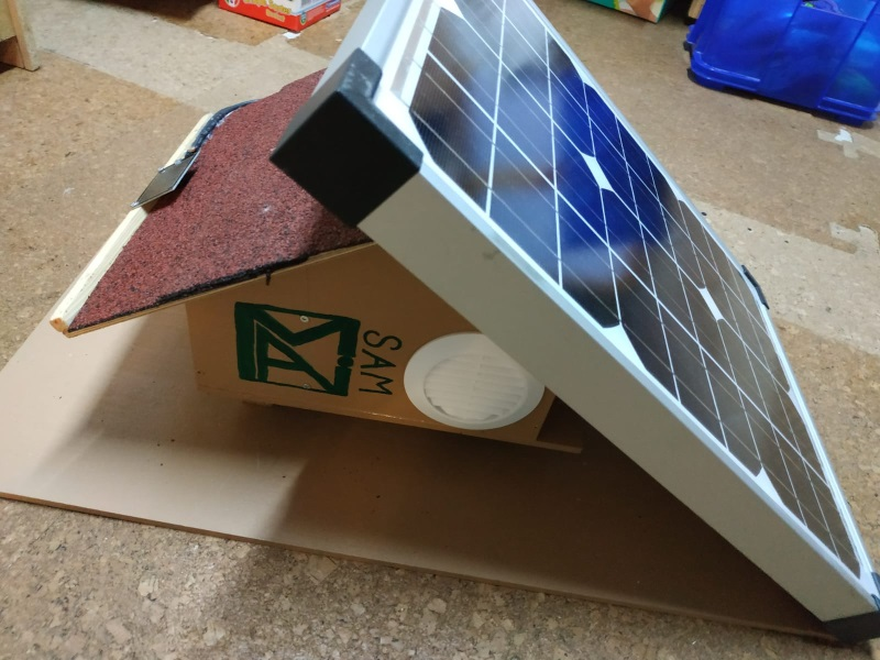 In the picture you can see the fully assembled SAM with the MAI logo on front and a solar panel on its roof.
